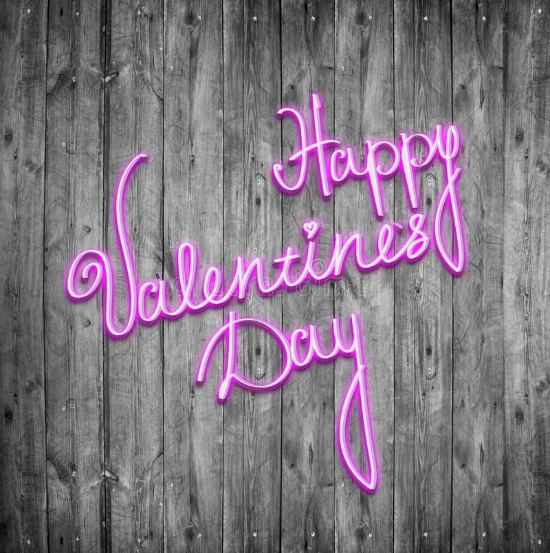 Szczęśliwy valentines dzień neonowy podpisuje drewnianego tło zdjęcia stock