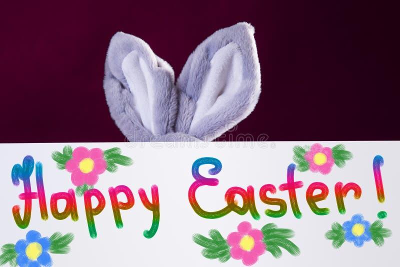 Szczęśliwy Wielkanocny sztandar z kwiatami i królików ucho za on fotografia royalty free