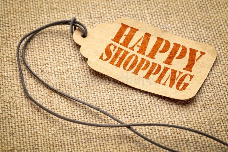 Szczęśliwy zakupy - tekst na metce obrazy stock