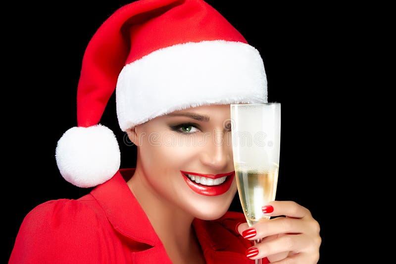Szczęśliwych bożych narodzeń dziewczyna Wznosi toast z szampanem w Santa kapeluszu otucha obrazy stock