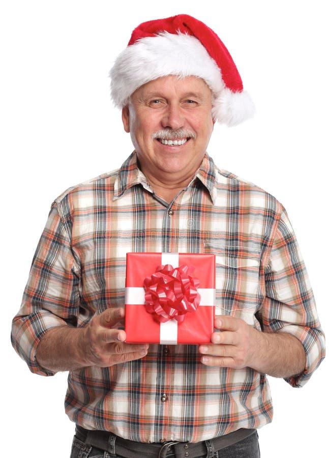 Szczęśliwych bożych narodzeń mężczyzna z xmas prezentem. zdjęcie stock