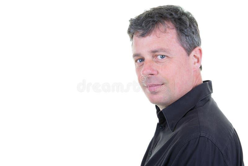 Szczęśliwych W Średnim Wieku mężczyzny portreta niebieskich oczu pozytywny uczucie z strony kopii przestrzenią obraz stock