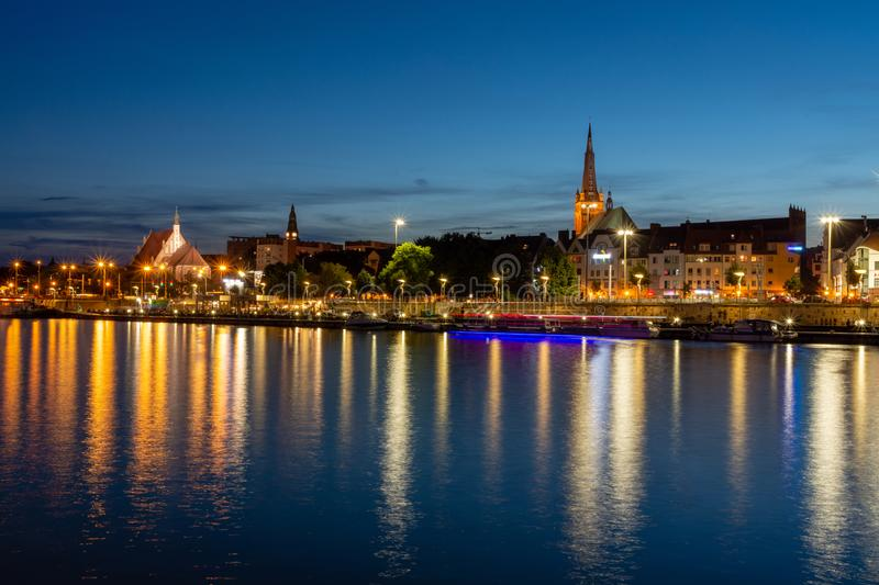 Szczecin in Poland. Light reflections of buildings in the river. Szczecin in Poland. Long Bridge after dusk, architecture, city, cityscape, europe, night, river stock image