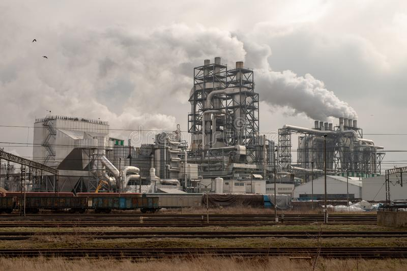 Szczecinek, zachodniopomorskie / Poland - March, 21, 2019: A modern wood processing plant. Smoking chimneys in a factory in. Szczecinek. Season of the spring stock photos