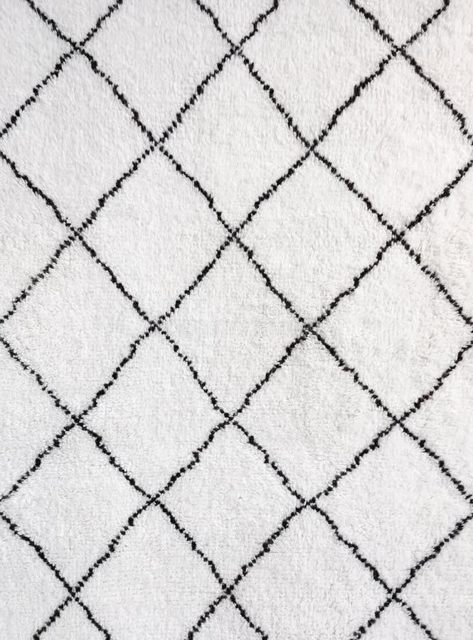 Szczegół biały dywanik z czarnymi liniami fotografia stock