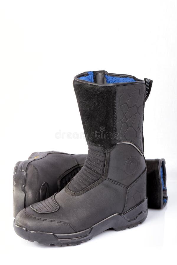 Szczegół para motocykli/lów buty odizolowywający obrazy stock