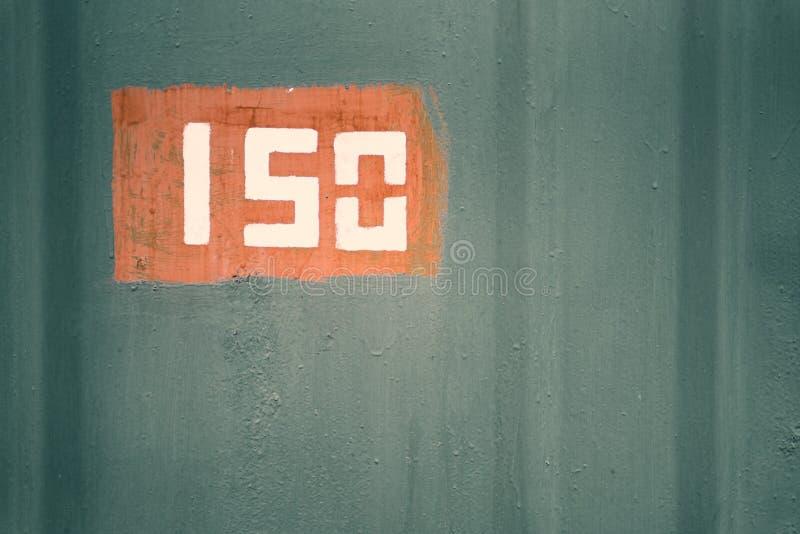 Szczegół stara malująca metal powierzchnia z liczbą, zbliżenie fotografia stock