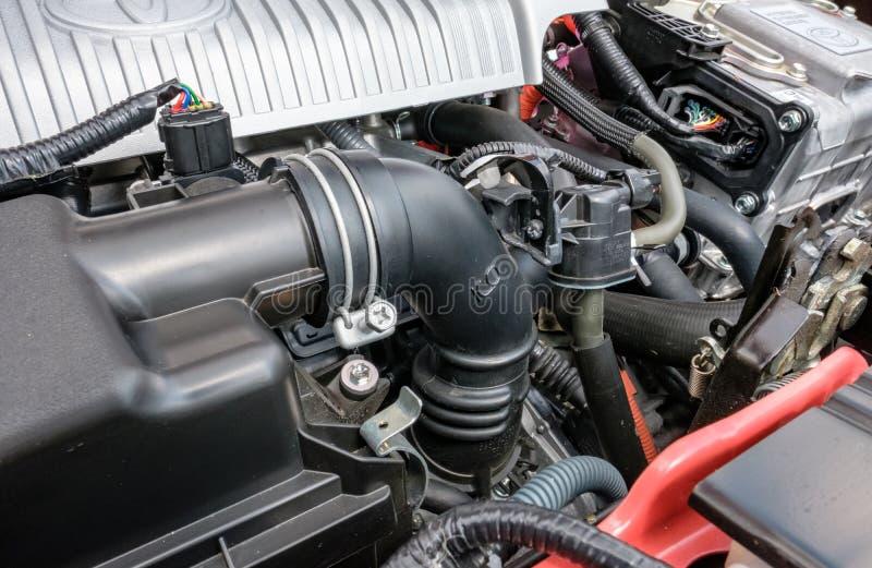 Szczegółowy widok japończyk fabrykował hybrydowego samochodowego silnika, pokazuje swój szczegółowe części w samochodowej sala wy fotografia royalty free
