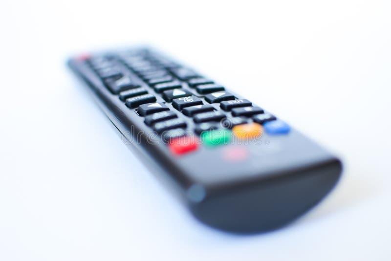 Szczególnie ciężko zamazani czarni pilot do tv dla TV na białym tle fotografia royalty free