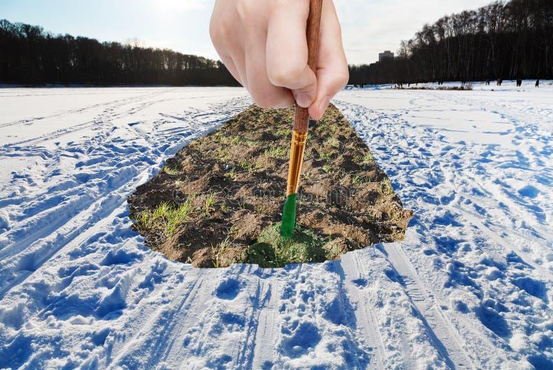 Szczotkarskie farby skaczą pług mlejący w śnieżnym polu obrazy stock
