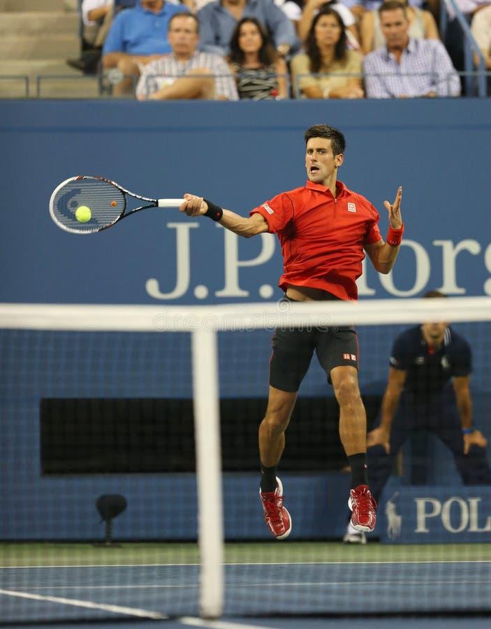Sześć czasu wielkiego szlema mistrzów Novak Djokovic podczas pierwszy round przerzedże dopasowanie przy us open 2013 obraz stock
