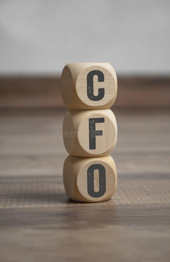 Sześciany i kostki do gry z CFO główy księgowy fotografia stock