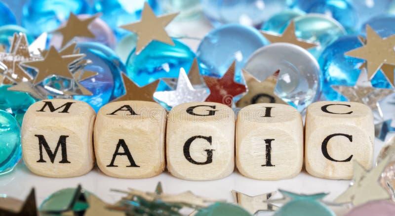 Sześciany z słowo magią obok gel piłek barwić gwiazd i - confetti ?wi?teczny obrazek obrazy royalty free
