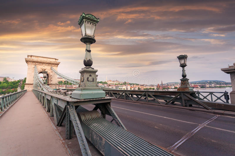 Szechenyi Chain Bridge in beautiful Budapest. Hungary. Szechenyi Chain Bridge in beautiful Budapest at sunset. Bridge over the Danube River, connects the two stock images