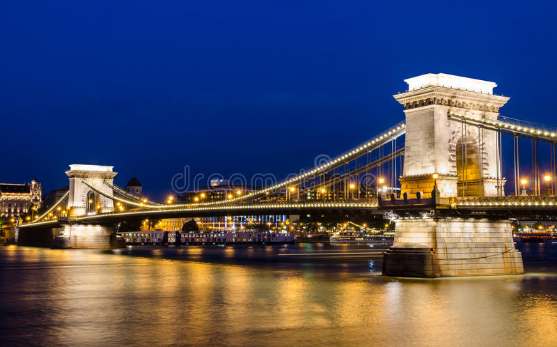 Szechenyi Chain Bridge in the night, Budapest. The Szechenyi Chain Bridge is a suspension bridge that spans the River Danube between Buda and Pest, the western royalty free stock photography