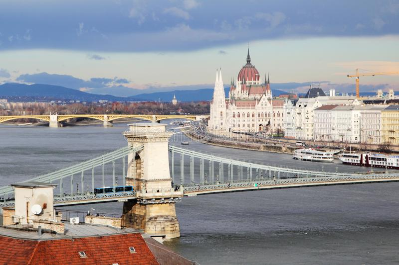 Szechenyi Chain Bridge and Pest district, Hungary. The Szechenyi Chain Bridge is a suspension bridge that spans the River Danube between Buda and Pest, the royalty free stock photos