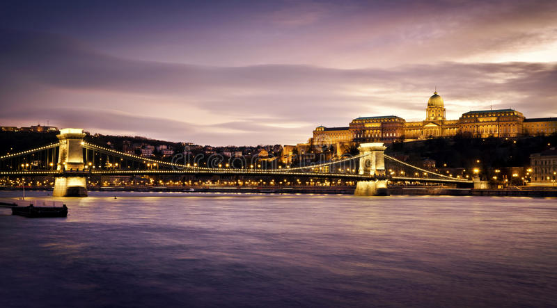 Szechenyi Chain Bridge and Royal Palace. Hungarian landmarks, Chain Bridge, Royal Palace and Danube river in Budapest at night royalty free stock images