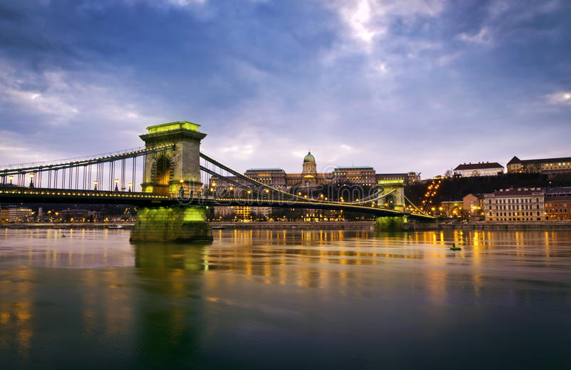 Szechenyi Chain Bridge and Royal Palace. Hungarian landmarks, Chain Bridge, Royal Palace and Danube river in Budapest at night royalty free stock photos