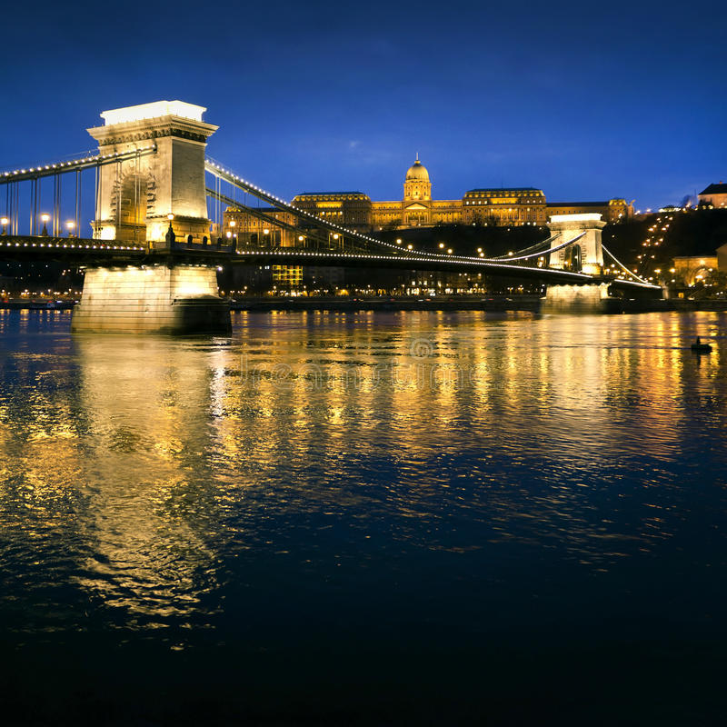 Szechenyi Chain Bridge and Royal Palace. Hungarian landmarks, Chain Bridge, Royal Palace and Danube river in Budapest at night royalty free stock photography