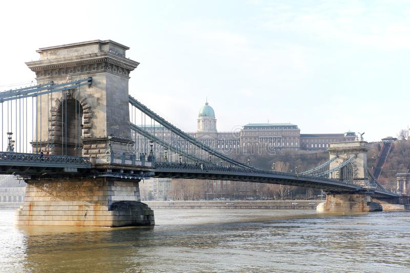 The famous Chain Bridge across the Danube river. The Buda Castle is in background, Budapest, Hungary, Europe. The Szechenyi Chain Bridge Széchenyi lánch stock photos