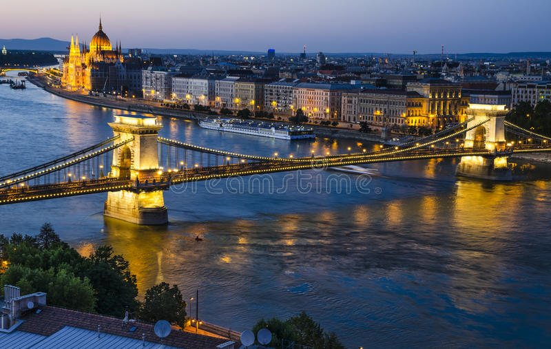 Szechenyi Chain or Lanchid bridge in night, Budapest. Szechenyi Chain Bridge is a suspension bridge on river Danube, Budapest, with Orszaghaz Hungary Parliament royalty free stock image