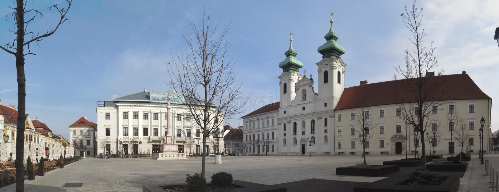 Szechenyi ter square with church and city hall in Gyor in Hungary royalty free stock images