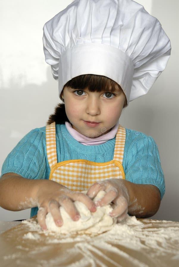 Szef kuchni dzieciak. zdjęcia stock