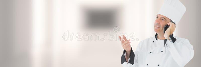 Szef kuchni na telefonie z zamazanym tłem obrazy stock