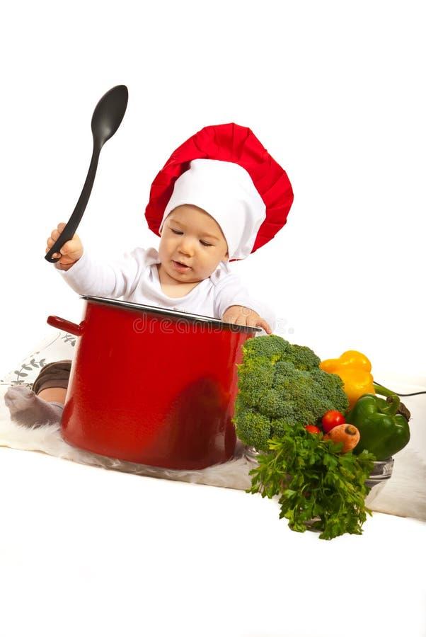 Szefa kuchni dziecka mienia łyżka obraz royalty free