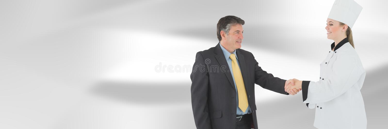 Szefa kuchni i kierownika chwiania ręki z zamazanym tłem obraz stock