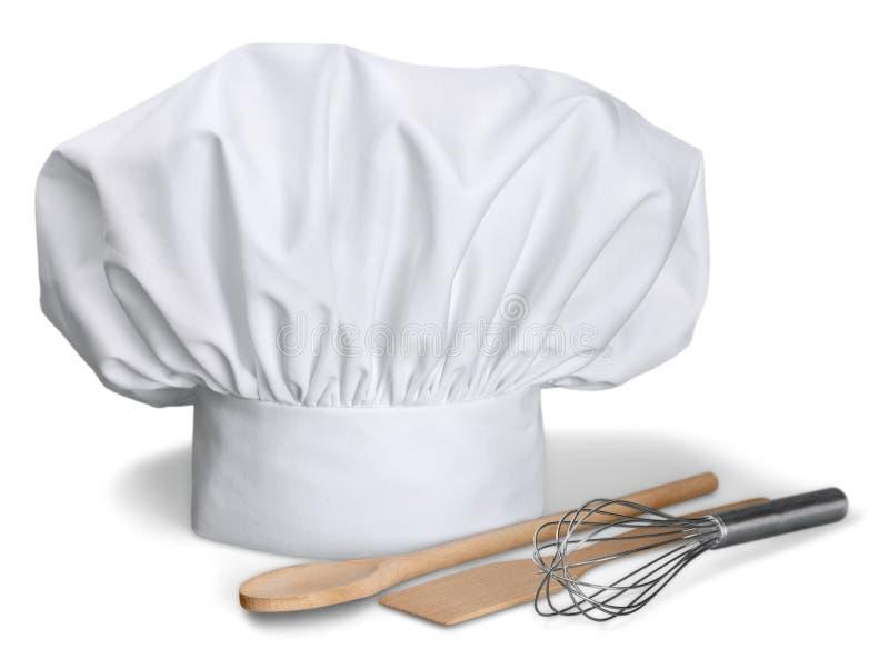 Szefa kuchni kapelusz z Kulinarnymi naczyniami obrazy royalty free