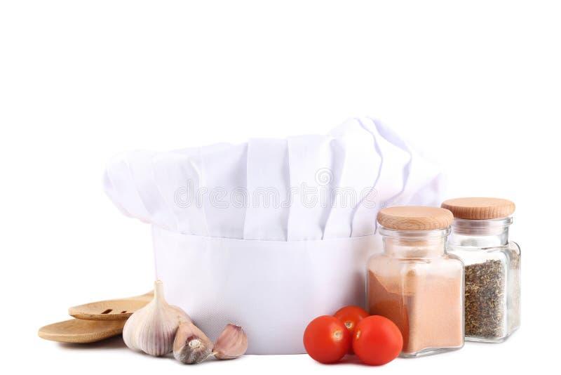 Szefa kuchni kapelusz z Kulinarnymi naczyniami zdjęcie royalty free