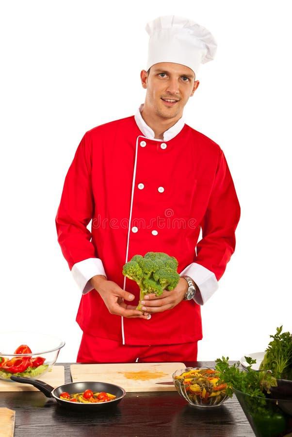 Szefa kuchni mężczyzna mienia brocolli zdjęcie royalty free