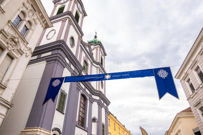 Cistercian Church of Saint John of Nepomuk and the sign of Royal Days Festival in old town of Szekesfehervar royalty free stock photography
