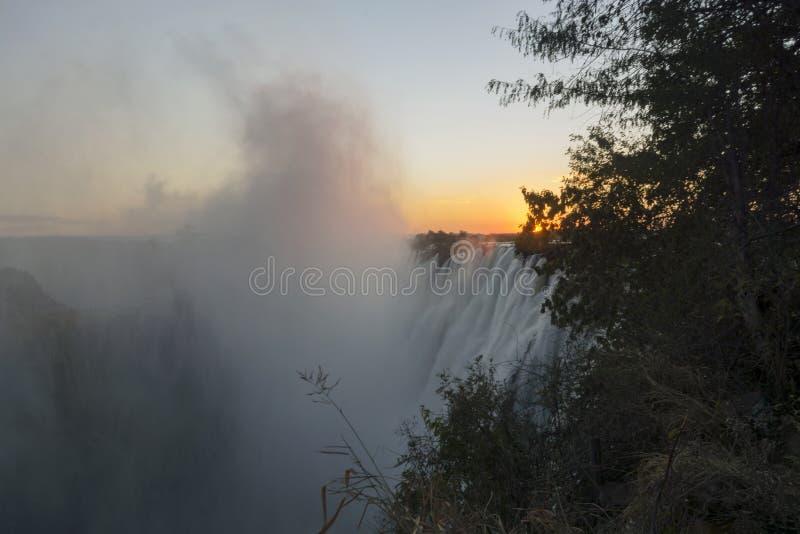 Szeroki widoku tła krajobrazu zmierzch Wiktoria Spada, Livingstone, zambiowie fotografia royalty free
