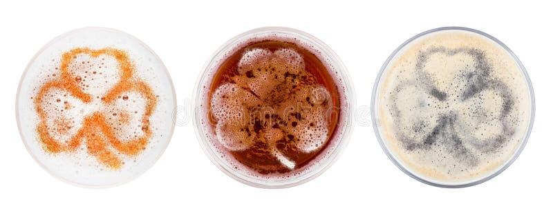Szkła czerwony ale porter i lager piwa shamrock zdjęcie royalty free