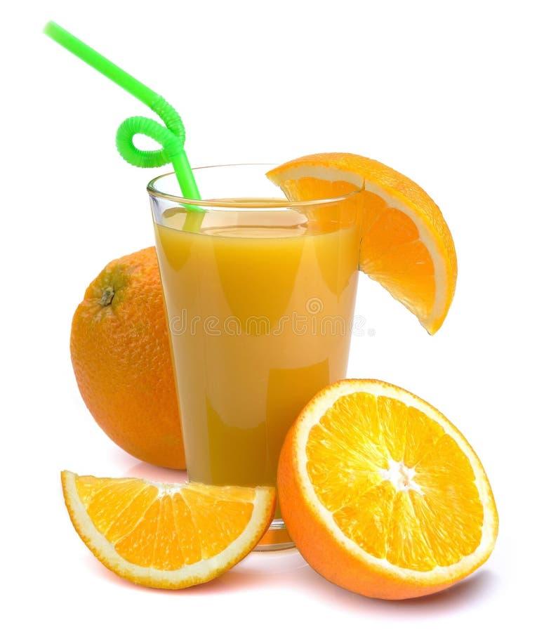 Szkło świeży sok pomarańczowy i owoc obrazy royalty free
