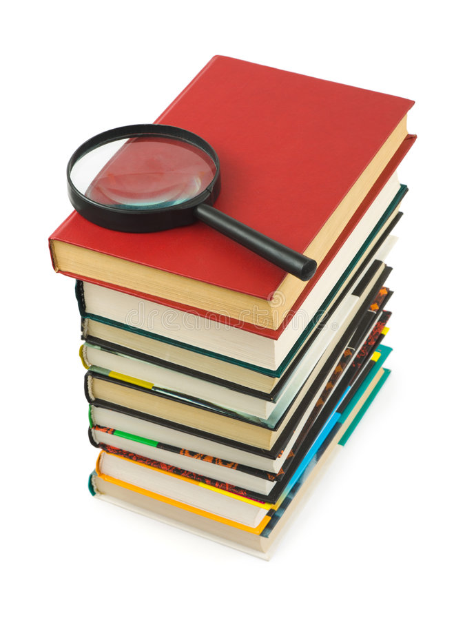 szkło powiększyć stosu książek zdjęcie stock