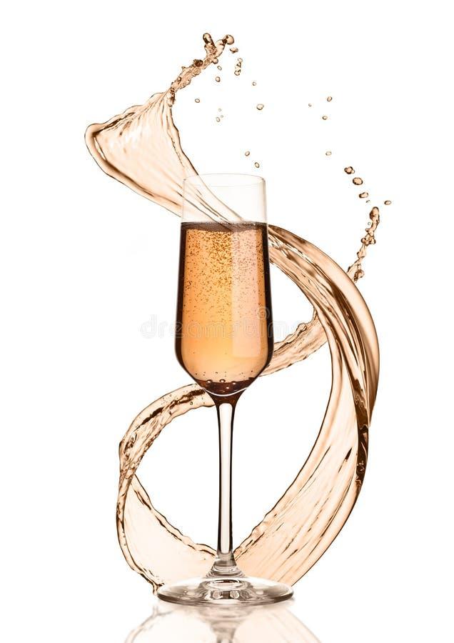 Szkło różowy szampan z pluśnięciami i bąblami obrazy royalty free