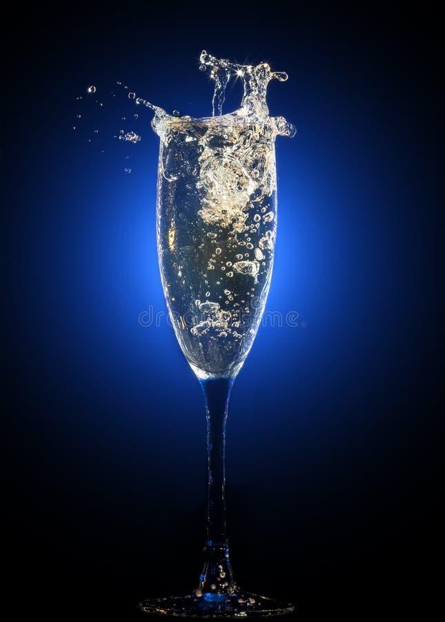 Szkło szampan z pluśnięciami zdjęcia stock