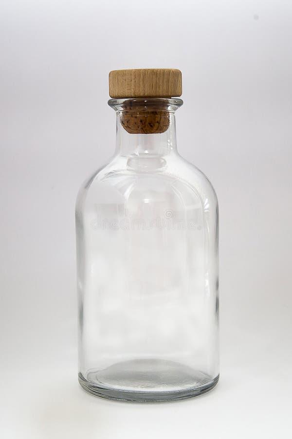 Szklana butelka odizolowywająca na białym tle fotografia royalty free