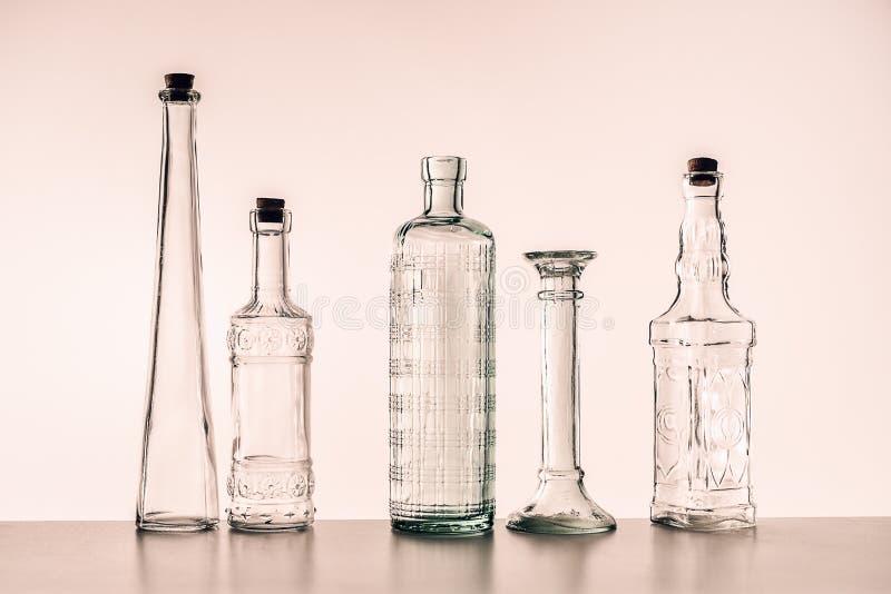 Szklane butelki różnorodni kształty zdjęcia royalty free