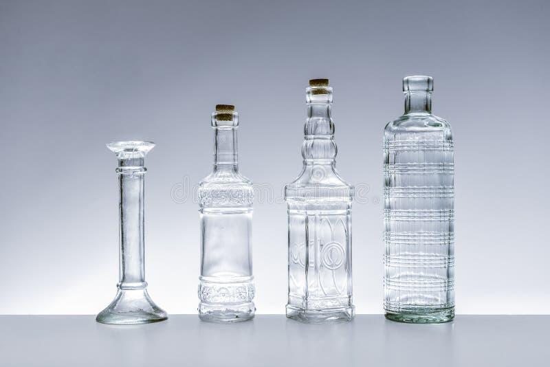Szklane butelki różnorodni kształty zdjęcie royalty free