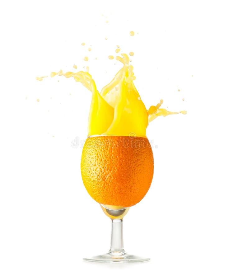 szklanego soku pomarańczowy spalsing zdjęcie stock
