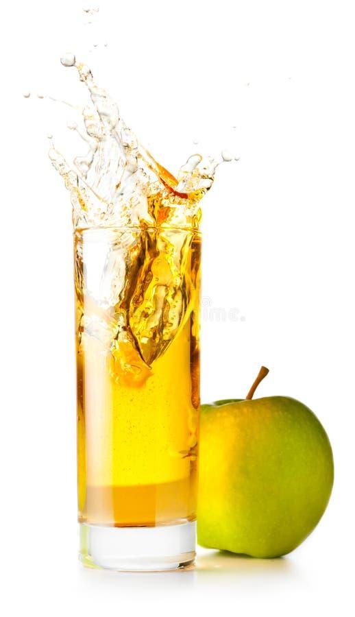szklanego soku pomarańczowy spalsing fotografia royalty free