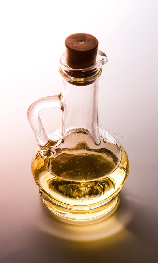 Szklani zbiorniki dla oleju z korkiem Backlight Brown cie? obraz royalty free