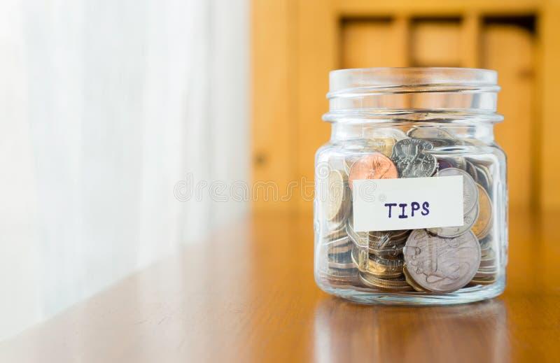 Szklany bank dla porad z pieniądze zdjęcia stock