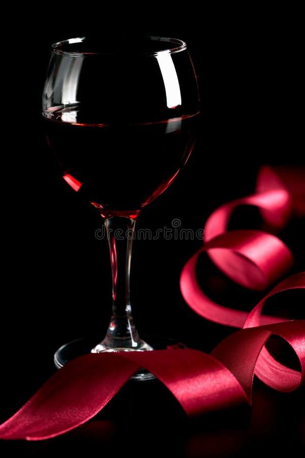 szklany czerwony tasiemkowy wino obraz stock
