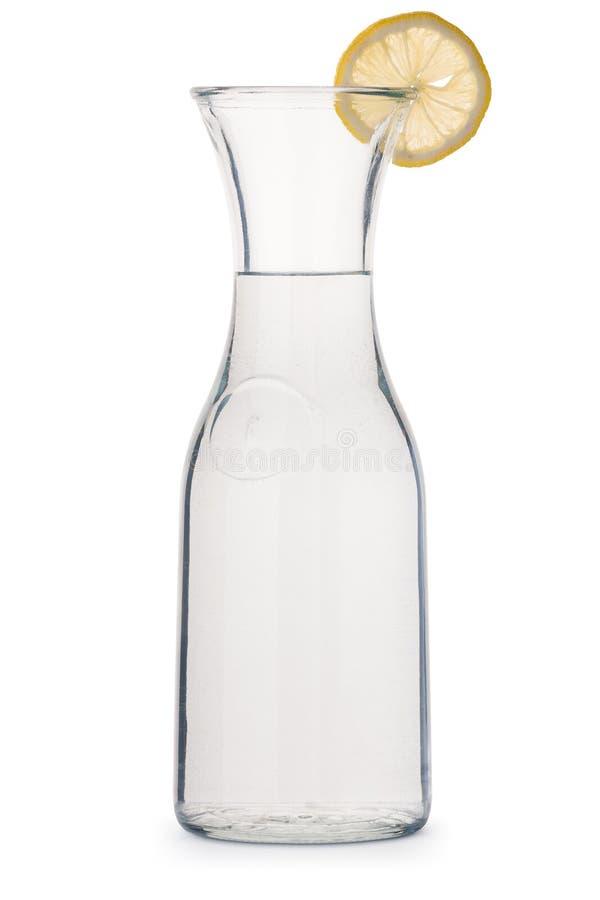 Szklany miotacz woda z cytryna klinem zdjęcia royalty free