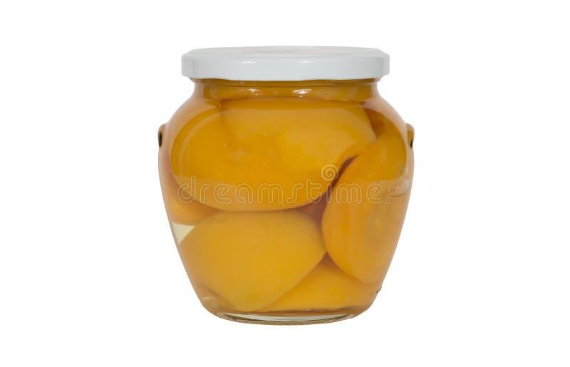 Szklany słój Konserwować brzoskwini połówki obraz stock